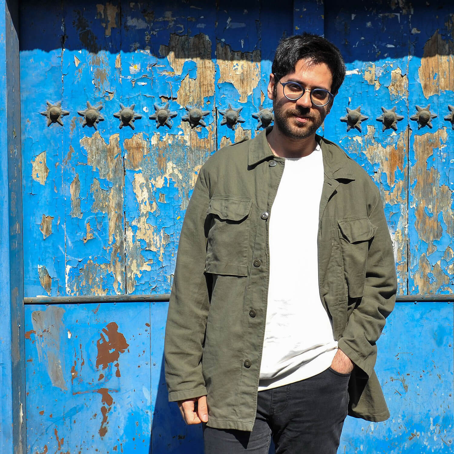 Artist Bamdad Afshar, blue door background